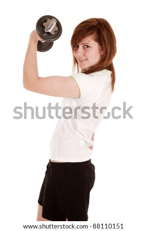 a woman lifting weights to make her biceps look bigger.