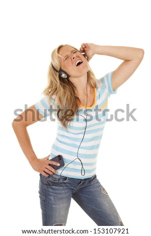A woman listening to her music and singing with her songs. - stock photo