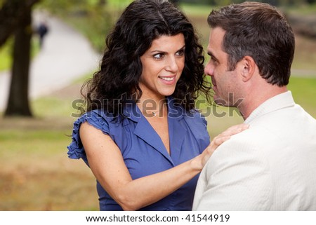 A woman looking at her husband with suspense - stock photo