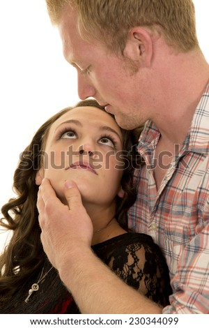 A woman looking into her man's eyes with a look of lust. - stock photo