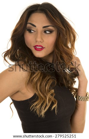 A woman looking over her shoulder, with a sensual expression on her face. - stock photo