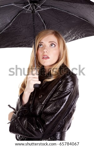 a woman looking up at her umbrella hoping to stay warm and dry. - stock photo