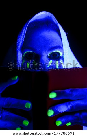 A woman looks like a ghost reading a book