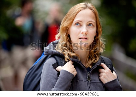 A woman lost while hiking in the forest - stock photo