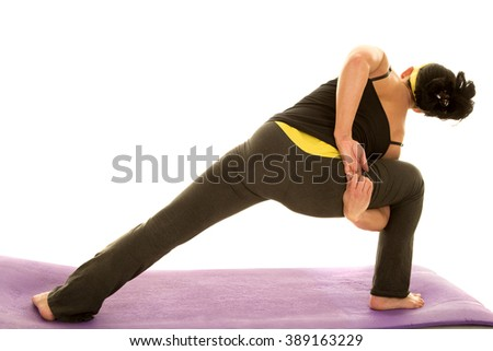 a woman lunging and stretching out her body. - stock photo