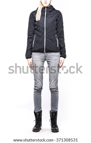 A woman(model, girl, female) stand up wearing blue jumper with hood, blue denim(jeans, pants, trousers), black leather military boots for winter isolated white at the studio.