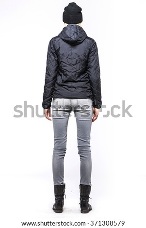 A woman(model, girl, female) stand up wearing blue jumper with hood, blue denim(jeans, pants, trousers), black leather military boots for winter isolated white at the studio. - stock photo