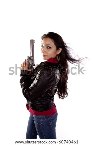 A woman on a white background holding a gun.  Her hair is blowing in the wind. - stock photo