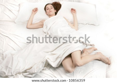a woman on the bed - stock photo