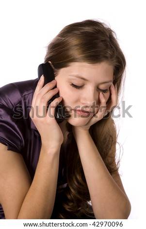 A woman on the phone tired of listening to the person on the other line. - stock photo