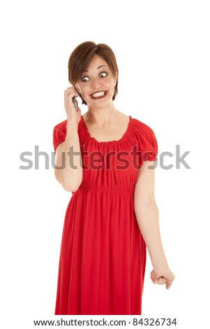 a woman on the phone with a crazy mad expression on her face.
