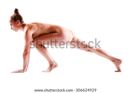 A woman performing nude Yoga.  - stock photo