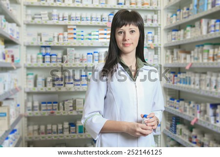 A Woman pharmacist at the pharmacy place - stock photo