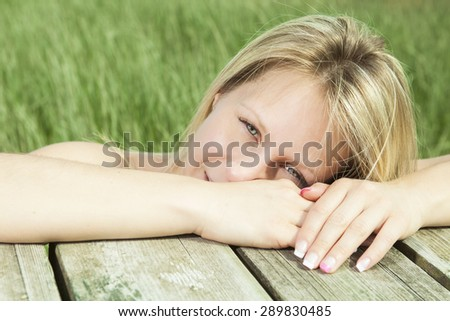 A woman portrait at the beach - stock photo