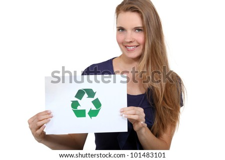 A woman promoting recycling. - stock photo