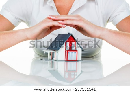 a woman protecting your home and home. good and reputable insurance financing calm. - stock photo