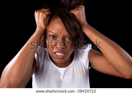 a woman pulls her hair in frustration