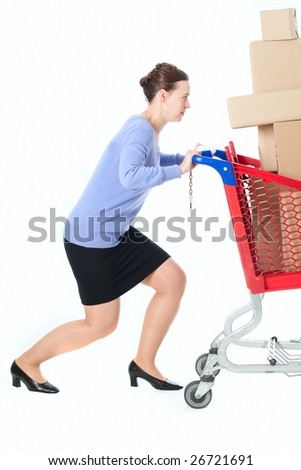 A woman pushing a heavily loaded cart - stock photo