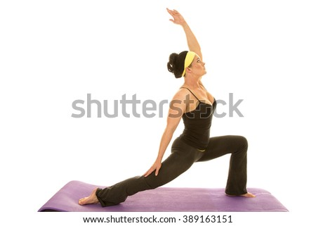 a woman reaching up doing her yoga stretch. - stock photo