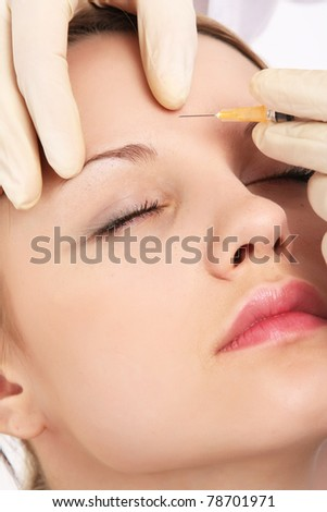 A woman receiving an injection - stock photo