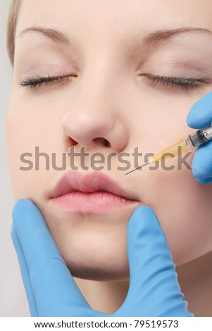 A woman receiving an injection, closeup - stock photo