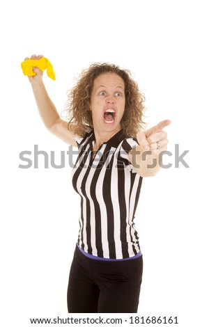 a woman referee yelling and getting ready to throw her yellow flag. - stock photo