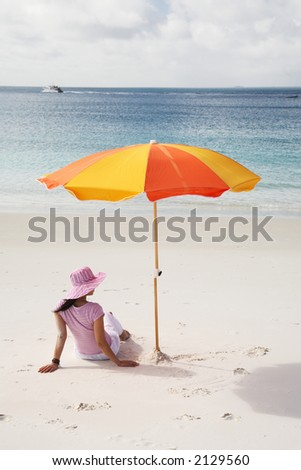 A woman relaxing on the beach in Whitehaven Beach, Whitsunday island