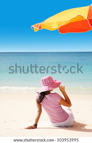 A woman relaxing on the beach in Whitsunday island - stock photo