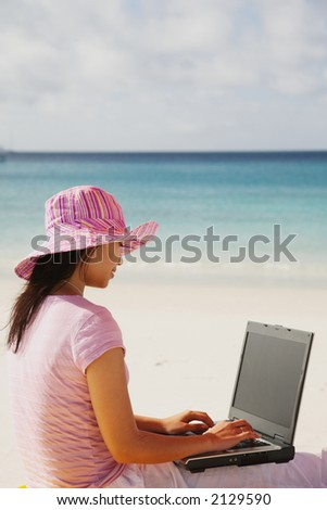 A woman relaxing on the beach in Whitsunday island