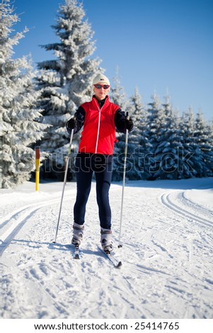 a woman runing cross-country ski. Skate style.