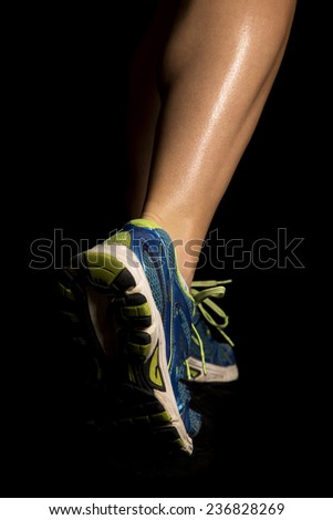a woman running with her legs all shiny. - stock photo