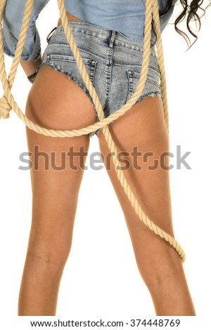 A woman's butt in her cut off shorts with a rope.