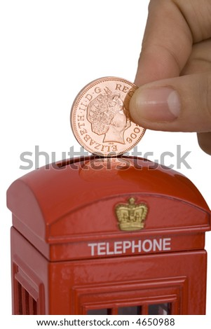 a woman's hand dropping a coin on a miniature phone booth over white background - stock photo