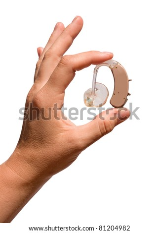 A woman's hand  holding a digital hearing aid  with earmould and tubing between her fingers. Isolated on white. - stock photo