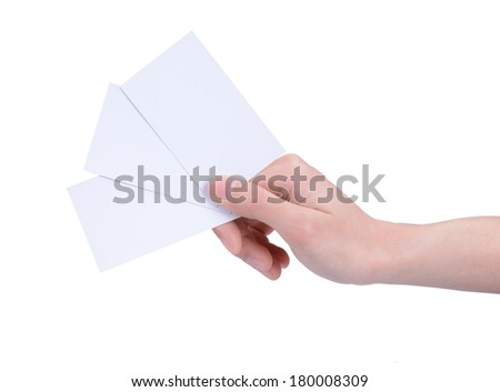 A woman's hand holding three cards - stock photo