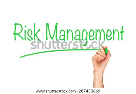 A woman's hand writing the word, Risk Management, on a clear screen. - stock photo