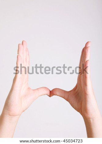 A woman's hands forming a shape. Space to insert text or design