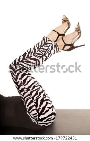 A woman 's legs in her zebra leggings. - stock photo