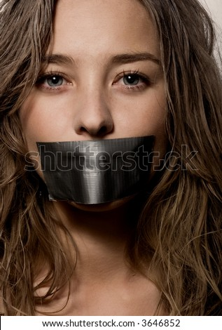 a woman's mouth sealed with a  scotch tape - stock photo