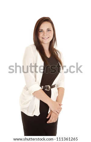 a woman sanding with a smile on her face. - stock photo