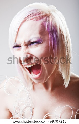 A woman screaming with crazy expression - stock photo