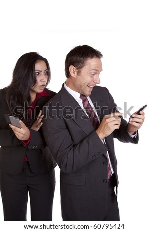 A woman sees what a man is texting and is mad about it. - stock photo