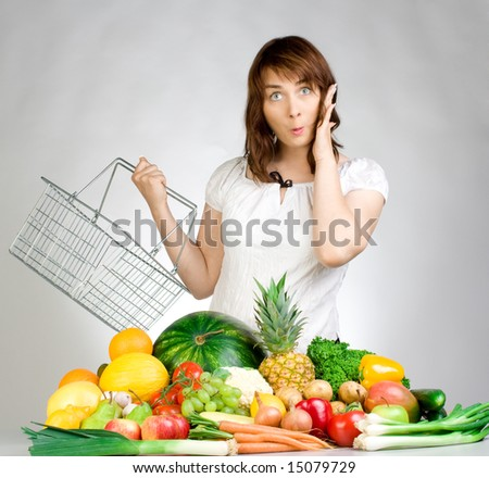 A woman shopping for fruits and vegetables. - stock photo