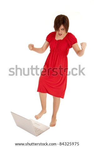 a woman showing her agression by stomping on her laptop.