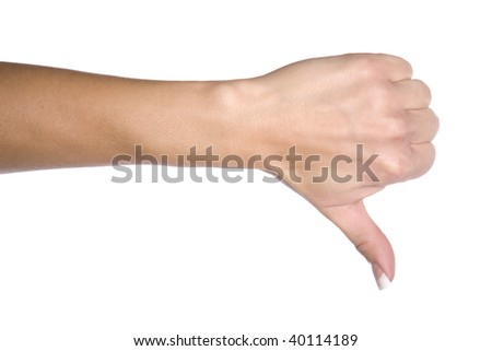 A woman showing her expression of no by using her hand with her thumb down. - stock photo