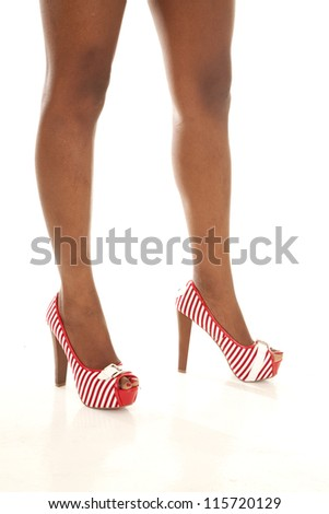 A woman showing off her red striped shoes. - stock photo