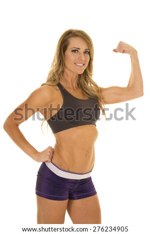 A woman showing off her toned and fit body. - stock photo