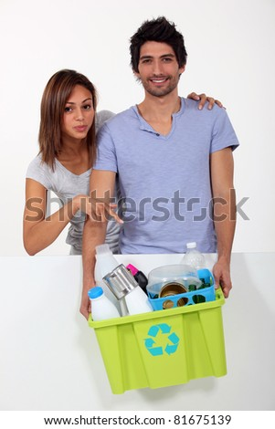 a woman showing ready to recycle materials - stock photo