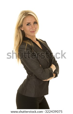 A woman showing some power with her arms folded in her business attire. - stock photo