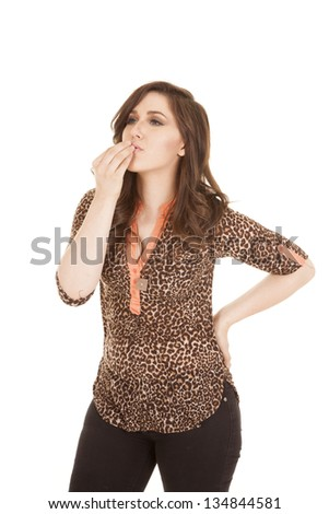 A woman showing the sign for eat with her hands. - stock photo